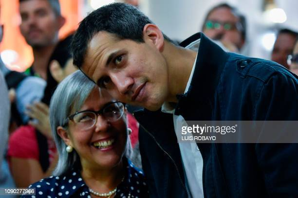 Venezuela's National Assembly head and selfproclaimed acting president Juan Guaido poses with his mother Norka Marquez during a mass in honour to the...