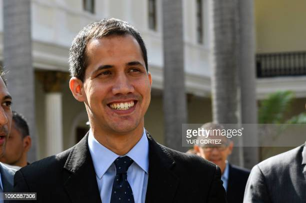 Venezuela's National Assembly head and selfproclaimed acting president Juan Guaido arrives at the National Assembly in Caracas to attend a session on...