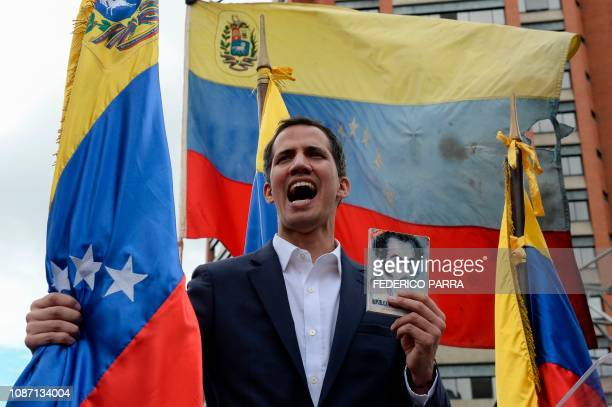 "Venezuela's National Assembly head Juan Guaido declares himself the country's ""acting president"" during a mass opposition rally against leader..."