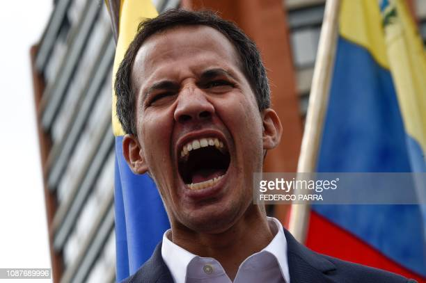 TOPSHOT Venezuela's National Assembly head Juan Guaido shouts as he speaks to the crowd during a mass opposition rally against leader Nicolas Maduro...