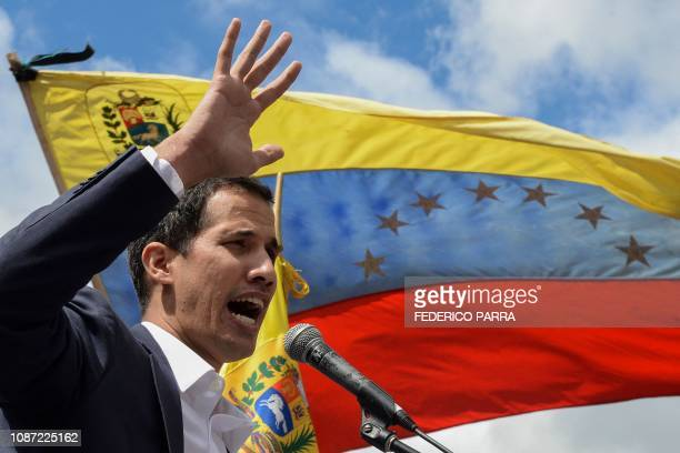 Venezuela's National Assembly head Juan Guaido speaks to the crowd during a mass opposition rally against leader Nicolas Maduro in which he declared...