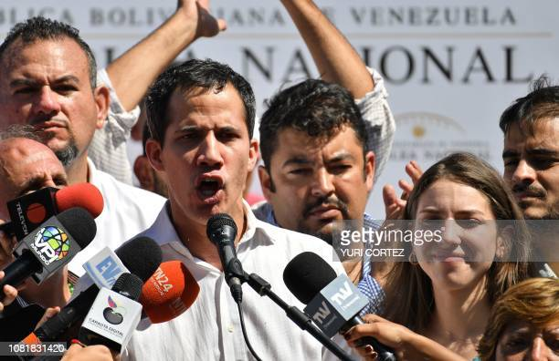 Venezuela's National Assembly president Juan Guaido accompanied by his wife Fabiana Rosales gestures before a crowd of opposition supporters during...