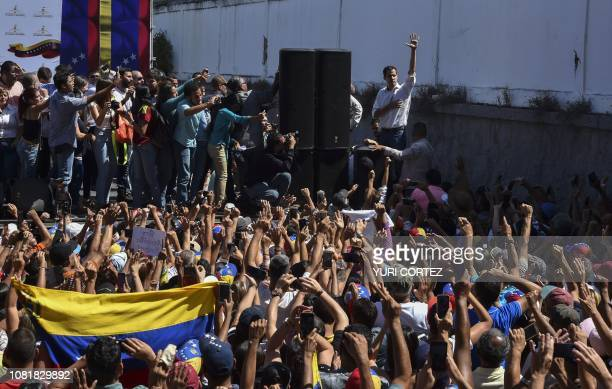 Venezuela's National Assembly president Juan Guaido gestures at opposition supporters during an open meeting in Caraballeda Vargas State Venezuela on...