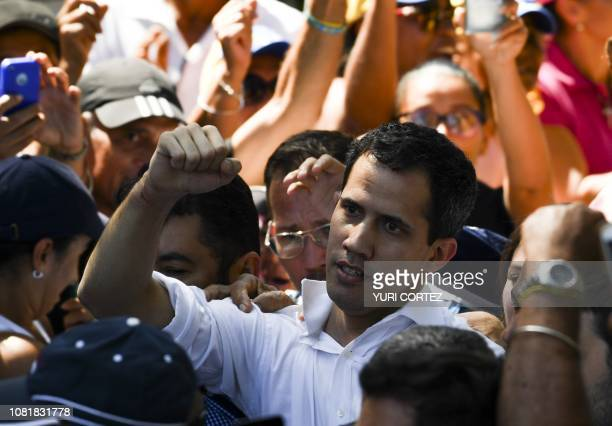 Venezuela's National Assembly president Juan Guaido is greeted by opposition supporters during an open meeting in Caraballeda Vargas State Venezuela...