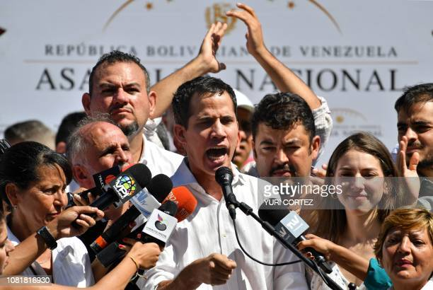 Venezuela's National Assembly president Juan Guaido speaks before a crowd of opposition supporters during an open meeting in Caraballeda Vargas State...