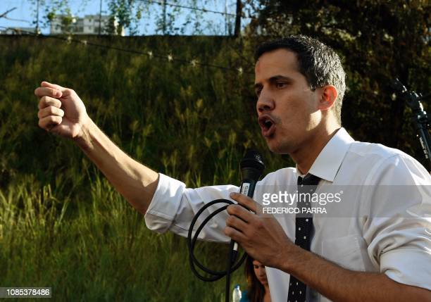 Venezuela's National Assembly president Juan Guaido speaks before a crowd of opposition supporters during an open meeting at the Caricuao...