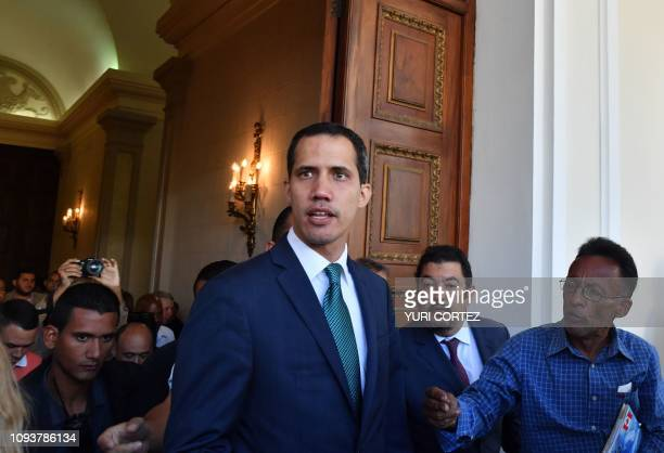 Venezuela's opposition leader and selfproclaimed acting president Juan Guaido arrives at the Federal Legislative Palace which houses both the...