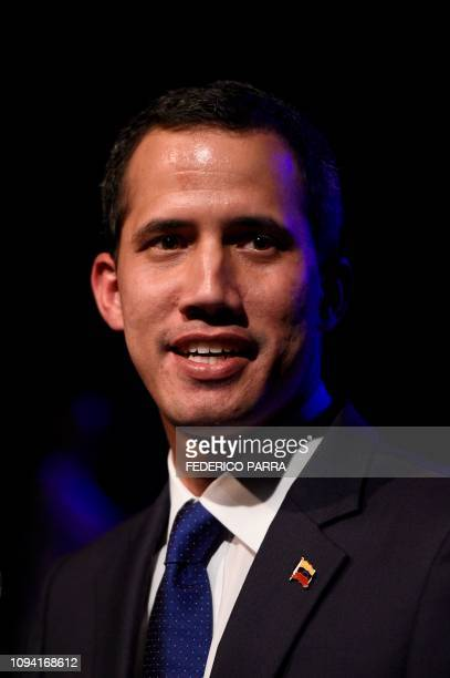 Venezuela's opposition leader and selfproclaimed acting president Juan Guaido delivers a speech during a meeting at the Venezuelan Federation of...