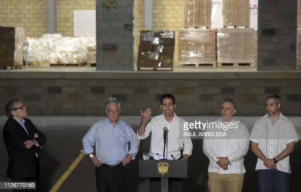 Venezuela's opposition leader Juan Guaido accompanied by the head of the Organization of American States Uruguayan Luis Almagro Chilean President...