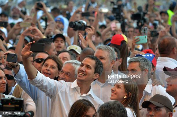 TOPSHOT Venezuela's opposition leader Juan Guaido takes a selfie his wife Fabiana Rosales Chilean President Sebastian Pinera Colombian President Ivan...