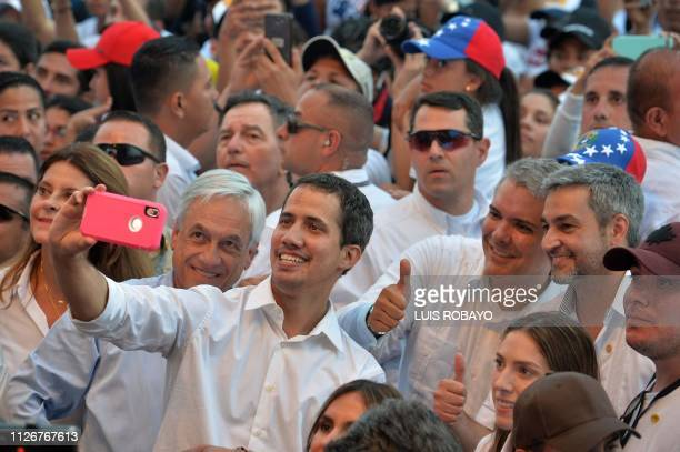 Venezuela's opposition leader Juan Guaido takes a selfie his wife Fabiana Rosales Chilean President Sebastian Pinera Colombian President Ivan Duque...