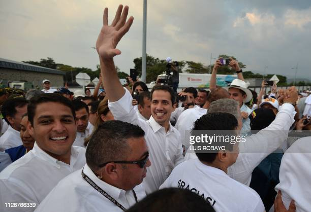 Venezuela's opposition leader Juan Guaido waves as he arrives at the Venezuela Aid Live concert organized to raise money for the Venezuelan relief...