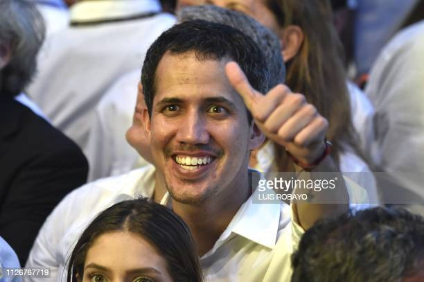 Venezuela's opposition leader Juan Guaido waves at the crowd during the Venezuela Aid Live concert organized to raise money for the Venezuelan relief...