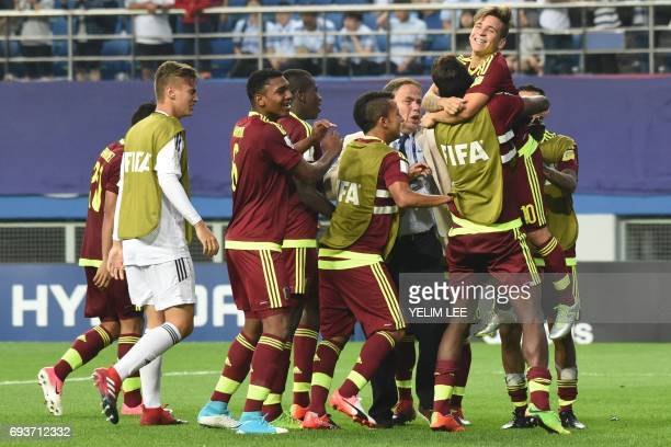 Venezuela's players celebrate victory during the U20 World Cup semifinal football match between Uruguay and Venezuela in Daejeon on June 8 2017 / AFP...