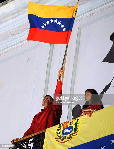 Venezuela's President Hugo Chavez celebrates his victory from the balcony of the Presidencial Palace in a referendum on constitutional changes would...