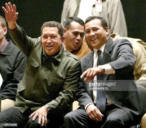 Venezuela's President Hugo Chávez flanked by comradeinarms Joel Acosta Chirino waves to supporters in Caracas 09 October 2002 The Venezuelan...