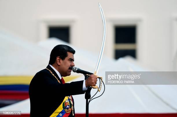 TOPSHOT Venezuela's President Nicolas Maduro brandishes a sabre while delivering a speech during the ceremony of recognition by the Bolivarian...