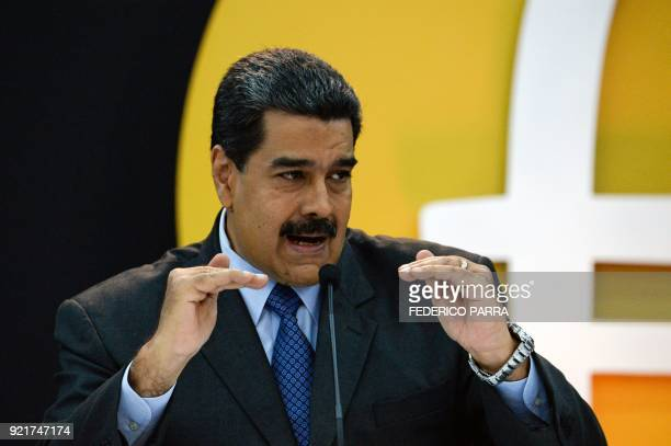 Venezuela's President Nicolas Maduro delivers a speach during a press conference to launch to the market a new oilbacked cryptocurrency called...