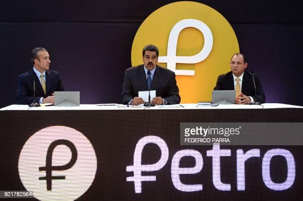 Venezuela's President Nicolas Maduro delivers a speach next to VicePresident Tarek El Aissami next to Venezuela's Minister of Science Technology and...