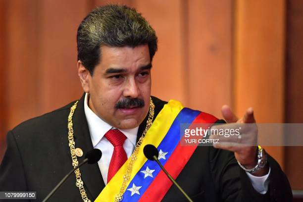 Venezuela's President Nicolas Maduro delivers a speech after being swornin for his second mandate at the Supreme Court of Justice in Caracas on...