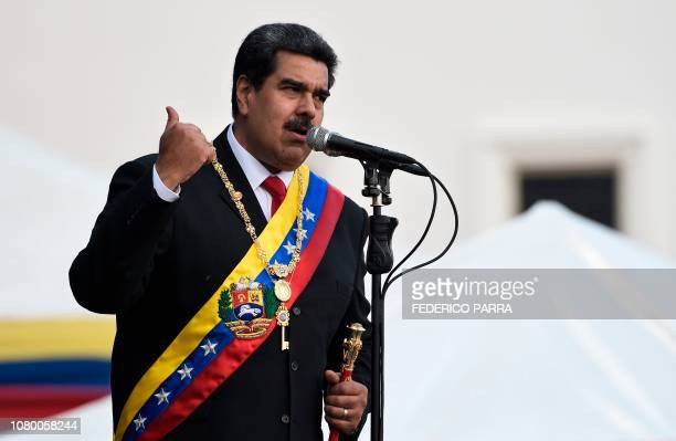 Venezuela's President Nicolas Maduro delivers a speech during the ceremony of recognition by the Bolivarian National Armed Forces after being sworn...