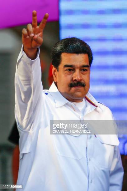 Venezuela's President Nicolas Maduro flashes the V sign in the framework of the 'Youth Day' celebrations at the Bolivar Square in Caracas Venezuela...
