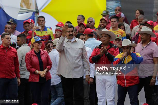 Venezuela´s President Nicolas Maduro gestures as he arrives for a gathering with supporters outside Miraflores Palace on April 6 2019 in Caracas...