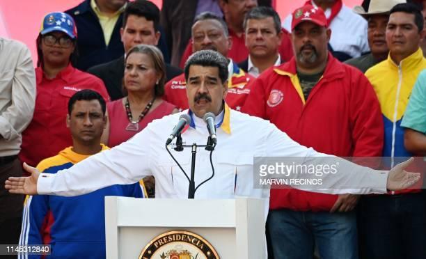 Venezuela's President Nicolas Maduro gestures as he speaks during a rally in front of Miraflores Presidential Palace in Caracas on May 20 2019...