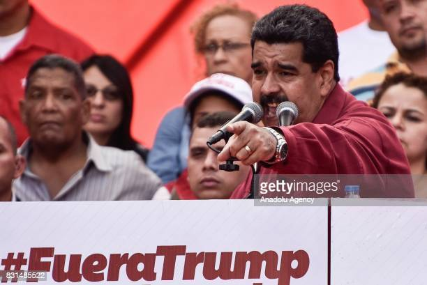 Venezuela's President Nicolas Maduro gestures as he speaks during a rally supporting him and opposing US President Donald Trump in Caracas on August...