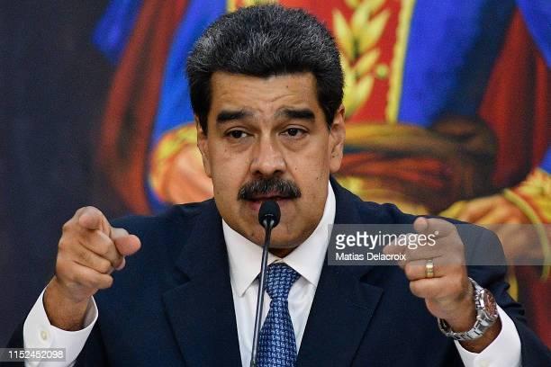 Venezuela's President Nicolas Maduro gestures as he speaks during the Simon Bolivar Journalism National Award ceremony at Palacio de Miraflores on...
