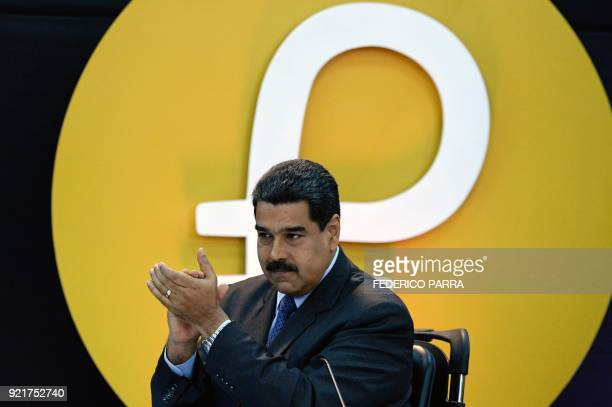 Venezuela's President Nicolas Maduro gestures during a press conference to launch to the market a new oilbacked cryptocurrency called 'Petro' at the...