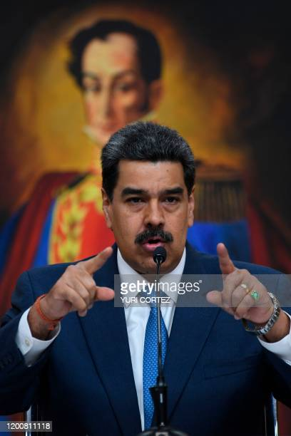 Venezuela's President Nicolas Maduro gestures during a press conference with members of the foreign media at Miraflores palace in Caracas, on...
