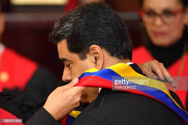 Venezuela's President Nicolas Maduro is swornin by the president of the Supreme Court of Justice Maikel Moreno during the inauguration ceremony of...
