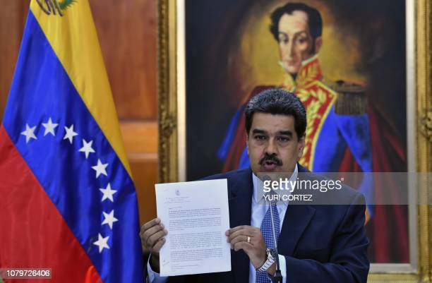 Venezuela's President Nicolas Maduro shows a statement to warn the Lima Group that he would take energetic measures if they do not rectify their...