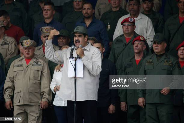 Venezuela's President Nicolas Maduro speaks during a military parade to commemorate the Day of the Bolivarian Militias the Armed People and the April...