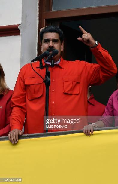 Venezuela's President Nicolas Maduro speaks from a balcony at Miraflores Presidential Palace to a crowd of supporters to announce his is breaking off...
