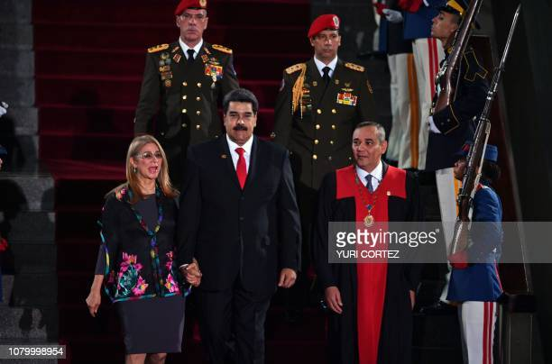 TOPSHOT Venezuela's President Nicolas Maduro walks flanked by First Lady Cilia Flores and the president of the Supreme Court of Justice Maikel Moreno...