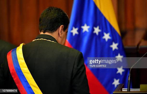 Venezuela's President Nicolas Maduro walks to the dais to deliver a speech after being swornin for his second mandate at the Supreme Court of Justice...