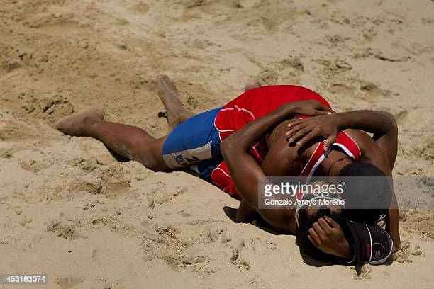 Venezuela's Rolando 'Peter' Hernandez embraces his teammate Jose Gregorio 'Tigrito' Gomez after winning the Men Third Place match against The...
