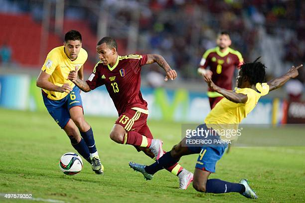 Venezuela's Romulo Otero vies with Ecuador's Christian Noboa and Juan Carlos Paredes during their Russia 2018 FIFA World Cup South American...