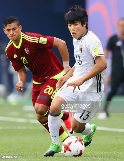 Venezuela's Ronald Hernandez and Yuto Iwasaki of Japan vie for the ball in the first half of an Under20 World Cup round of 16 match in Daejeon South...