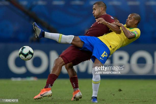 TOPSHOT Venezuela's Salomon Rondon and Brazil's Fernandinho vie for the ball during their Copa America football tournament group match at the Fonte...