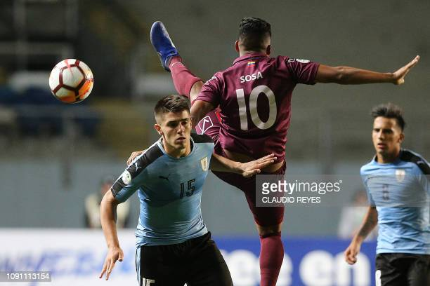 TOPSHOT Venezuela's Samuel Sosa vies for the ball with Uruguay's Edgar Elizalde during their South American U20 football match at El Teniente stadium...
