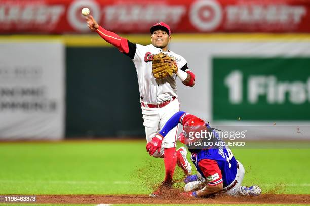 Venezuela's second baseman forces out at second base Puerto Rico's Henry Ramos during the Caribbean Series baseball tournament at the Hiram Bithorn...