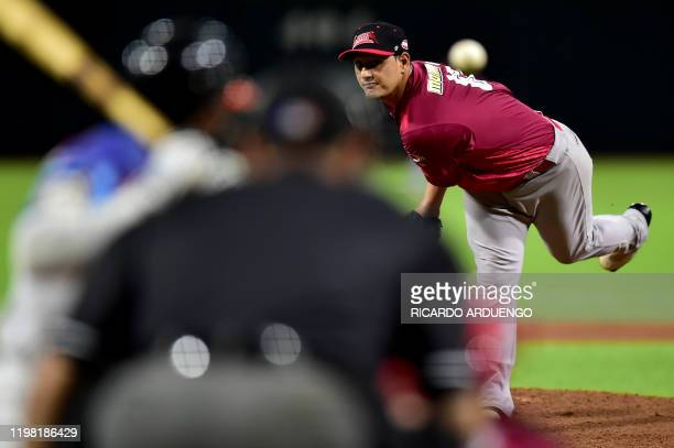 Venezuela's starting pitcher Wilfredo Ledezma throws during the first inning during a Caribbean Series baseball game against the Dominican Republic...