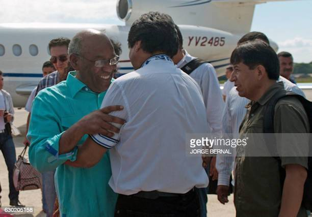 Venezuela's Vice President Aristobulo Isturiz is welcomed by Bolivia's President Evo Morales and Foreign Minister David Choquehuanca upon his arrival...