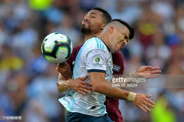 TOPSHOT Venezuela's Yangel Herrera and Argentina's Marcos Acuna vie for the ball during the Copa America football tournament quarterfinal match at...