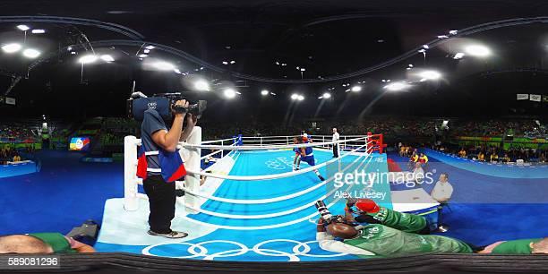 Venezuela's Yoel Segundo Finol fights Dominican Republic's Leonel De Los Santos Nunez during the Men's Fly at the Rio 2016 Olympic Games at the...