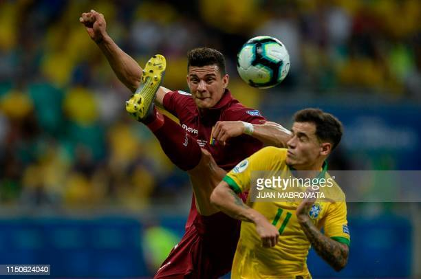 TOPSHOT Venezuela's Yordan Osorio and Brazil's Philippe Coutinho vie for the ball during their Copa America football tournament group match at the...