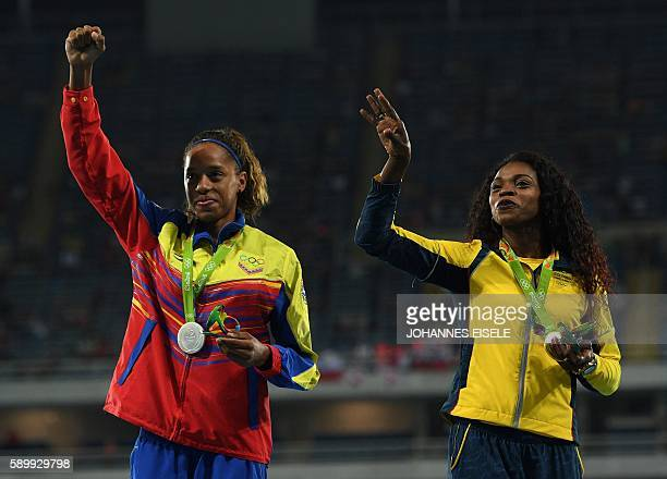 Venezuela's Yulimar Rojas and Colombia's Caterine Ibarguen pose during the podium ceremony for the women's Triple Jump during the athletics event at...